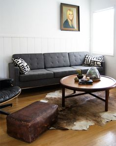 leather ottoman & cow skin rug.