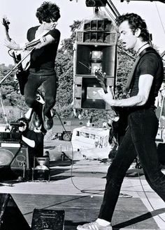 The Stranglers' Jean-Jacques Burnel and Hugh Cornwell playing in Battersea Park in London in 1978.