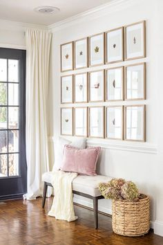 An entryway decorated for fall with a budget-friendly way to use leaves and flowers from your backyard for free art and decor.