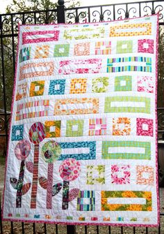 Just in time for spring is this gorgeous jelly roll quilt pattern that uses geometric shapes and cute little flowers to make a really sensational design. Combine different jelly rolls and make a bright collage of color.