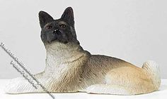 """Bring this miniature Akita home to your dollhouse. His intelligent black face is highly alert, while his large beige-coloured body is laying relaxed on the floor of your dream dollhouse.  Dimensions: 3-1/2"""" long x 1-1/4"""" wide x 1-7/8"""" tall. functionality: Fixed,not posable.  $10.00 http://www.thelittledollhousecompany.com/dollhouses-miniatures-furniture-kits/miniature-laying-akita-for-dollhouses-1/"""