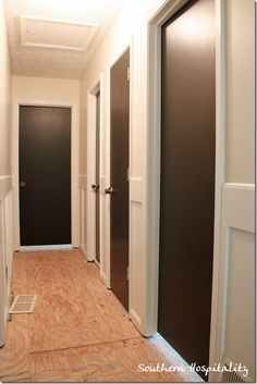 Doors are deep dark brown/black.  Not quite as stark as jet black and it will have a warmer feel with brown wood floors.  The color is Fired Earth by Valspar. (Paint + Primer)