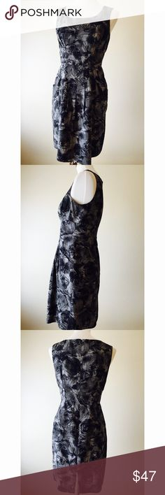 """Banana Republic Black & Gray Sheath Dress Banana Republic beautiful black and gray sheath dress🔹Size 6P: 34"""" bust, 34"""" length, 28"""" waist🔹Back concealed zipper🔹5"""" slit at hemline in back🔹Lined🔹Slip pockets🔹Excellent condition🔹Fabric: 55% silk, 45% wool🔹Dry clean🔹No trades🔹Smoke free home🔹Thank you for stopping by our closet💕 Banana Republic Dresses"""