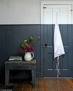 The striking dual-toned walls in the kitchen – half light grey plaster and half dark blue paint – are a fresh take on classic wall panelling; the crisp dividing line is a modern replacement for a dado rail, and with the contrasting lighter shade gives the Half Painted Walls, Half Walls, Painted Stairs, Dado Rail Bedroom, Dado Rail Living Room, Dado Rail Hallway, Two Tone Walls, Easy Wood Projects, Dark Blue