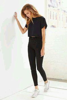 Black crop top. Black jeans. White converse.
