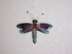 TD1  Dragonfly made with clay and a Raku by Runninghorsegallery