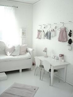 little white room. Love it!!!! Especially love the clothes as display. I want to do this with her shoes as well.