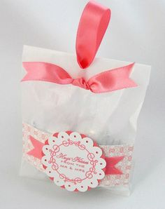 great idea for party favor for a small treat- ribbon with label and glassine bag