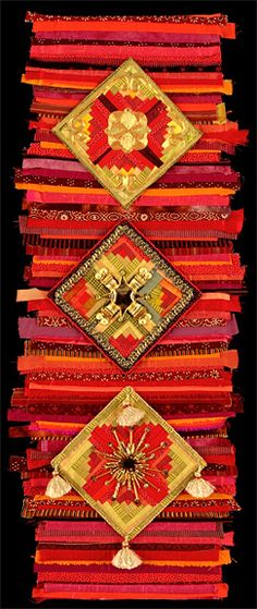 "Trade Route Treasure  32"" h x 12"" w  Pieced silks and cottons,  hand goldwork embroidery, ""RED SERIES:  These red pieces are inspired by the long history of the Silk Road and the many cultures that were involved with trade along it.  Hand made textiles still identify many cultural groups along that long route and the value placed on stitched everyday objects is wonderful.""  Marianne Burr, Hand Stitched Art"