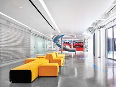 Slides and Cars Fill the Bold Edmunds.com HQ by M+M Creative Studio