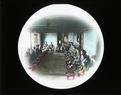 Large group seated for meal :: Japanese Lantern Slides (Dominican University)