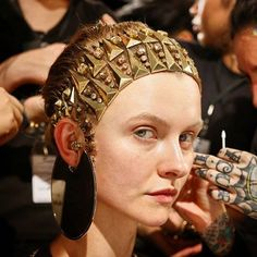 A fierce headpiece with gold sharp angles and jewels, Givenchy's S/S 2016 collection showcased large metal accessories. Gabriella Wimmer is on trend with her Small Marquise bag.