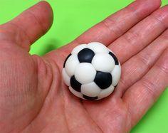 Fondant soccer ball in hands close