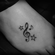 Music note with heart tattoo