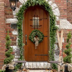 When in doubt, a symmetrical arrangement of Christmas decorations always looks polished: http://www.bhg.com/christmas/outdoor-decorations/front-door-christmas-decorating-ideas/?socsrc=bhgpin121614useasymmetricaldesign&page=10