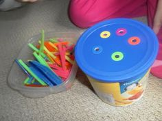 Straws and pipe cleaners- through the right coloured hole