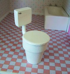 Creative use of clay flowerpot as bathroom stand ~ TIP: use magnetic strips to create top that opens and closes  | Source: 5 dollar dollhouse