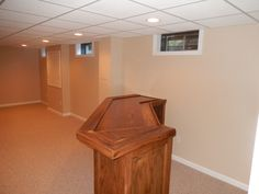 Custom oak bar and finishes man cave by Better Built Basements