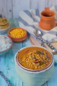 Vatha Kuzhambu – Traditional and a staple recipe of South India. A tamarind based gravy. Super spicy and tangy. Served as a main course with rice.  Gluten free and vegan side dish for rice.