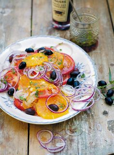 Moroccan Salad Recipe (The flavors of southern France collide with North African influences in this Moroccan salad recipe. It tastes of acidity from the tomatoes, a touch of sharpness from the red onion, and the brininess of olives.)
