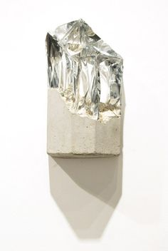 Mixed materials of silver and cement by Richard Tuttle