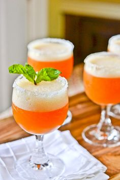 Peach Champagne Cocktails: cup sugar, to rim glasses 1 pint peach sorbet 1 shots Triple Sec shot cognac, such as Courvoisier Chilled champagne or sparkling wine, to fill blender, bottle Raspberries and 4 springs mint Refreshing Drinks, Fun Drinks, Yummy Drinks, Beverages, Fruity Cocktails, Frozen Cocktails, Triple Sec, Great Recipes, Favorite Recipes