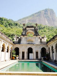 An ancient pool surrounding by architectural details and sky-high cliffs...yes please!
