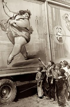 Kids checking out the freak show. The fat lady always got payed $1 per pound each show they did. But they usually didn't weigh as much as they where advertised