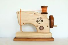 These beautiful sewing machines are handcrafted in New Zealand out of solid wood - native matai and pine - using an original Needle & Nail design with an oiled finish. The needle gently rises and falls as the handle is turned clockwise which makes a lovely rhythmic sound. Unlike most other wooden toy sewing machines which have the mechanism on the outside, this sewing machine has the mechanism sealed inside. This reduces the potential for injuries and breakages by curious little enginee...