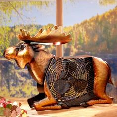This handcrafted steel moose fan adds a distinctive touch of whimsy to your decor. From his realistic hooves to his majestic antlers and prominent head, this bronze moose will delight wherever you pla
