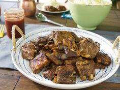 """Fred's Barbequed Pork Ribs : Once you prepare what Trisha calls """"Fred's Special Spray,"""" featuring lemon juice, vinegar and salty Worcestershire sauce, it's all about gently flavoring the ribs with the mixture as they cook slowly and at a low temperature."""