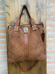 82eb8c81e1 Braided leather shoulder bag