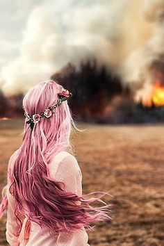 'tears ran down her cheeks as she saw her life go up in flames: her home, her love, her family, her life.'