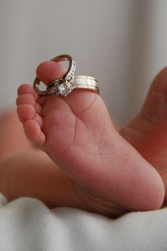 Newborn photo with wedding rings.