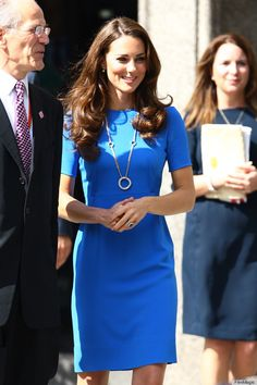 Kate in her signature blue with perfection in accessories