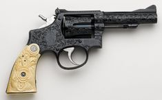 Custom engravings on a Smith & Wesson Revolver. I would give up a lot of things in my life to have this gun. Smith And Wesson Revolvers, Smith Wesson, Custom Motorcycle Parts, Custom Motorcycles, Guns Dont Kill People, Guns And Ammo, Bang Bang, Shotgun, Firearms