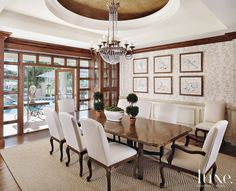 A Niermann Weeks #chandelier dazzles in its recessed nook above a classic Formations table. #Luxe