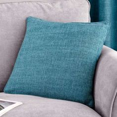Finished in a teal colourway with piped edging, this square cushion is filled with polyester hollowfibre and features a removable cover which is machine washabl...