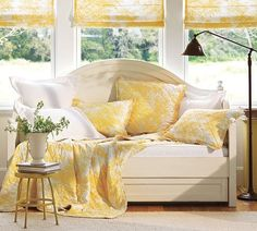 It's not only a lovely place to sit or relax, it's a trundle bed for guests. Pottery Barn