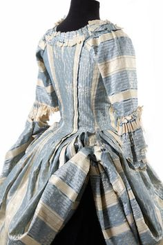 A blue & cream silk polonaise dress( robe a l'anglaise retroussee), circa Of pale blue and cream striped and floral damask silk, elbow length sleeves with altered sleeve frills 18th Century Dress, 18th Century Costume, 18th Century Clothing, 18th Century Fashion, Rococo Fashion, Victorian Fashion, Vintage Fashion, Historical Costume, Historical Clothing
