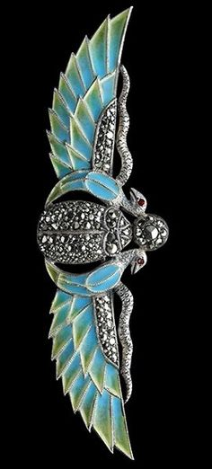 EGYTIAN REVIVAL, Winged Brooch, composed of silver, Plique-à-jour and marcasite. Marks: '935', German, c.1925.