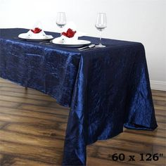 """Navy 60x126"""" Crinkle Taffeta Tablecloths /  Let this exquisite tablecloth enchant the entire ambiance of your special event with its seamless luster and upscale look. Blending the modern flair with traditional sophistication, this magnum opus is simply magnificent. Spread it atop your dreary tables or plain, lackluster table covers to achieve the excellence of class and vibrancy. The lovely crinkles accented all over the surface coupled with the impeccable metallic glint of lustrous taffeta…"""