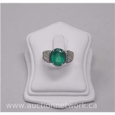 18kt White gold, Emerald (4.00ct) and Diamond Estate Ring. (9)