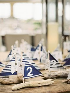 Driftwood escort cards.  55 Ways to Get a Little #Nautical on Your #Wedding Day via Brit + Co.