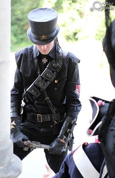 Top hat, jacket, guns, what's not to like