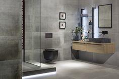 Minimalisticky zařízené koupelny v pánském stylu se stávají trendem moderního bydlení. Jejich chladný betonový vzhled je často zasazen do kontrastu s prvky v industriálním stylu, z kovu či skla. Pokud přece jenom hledáte zjemňující akcent této surové krásy, sáhněte po koupelnovém nábytku ve světlejších tónech dřeva a hrajte si se světlem. Celý prostor koupelny rázem ožije. Nabyde zvláštní až podmanivé působivosti. Bathtub, Bathroom, Awards, Home Decor, Dekoration, House, Standing Bath, Washroom, Bathtubs
