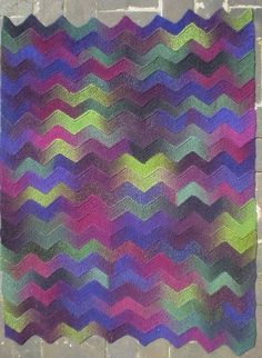 Ten Stitch Zigzag-This pattern is available as a free Ravelry download. Worked on just ten stitches, these garter stitch zigzag strips are joined as you go so there is no sewing up. This technique can be used to make blankets or scarves and works with any yarn and needles. The strips could also be knitted in different yarns making it a good pattern for using up oddments.