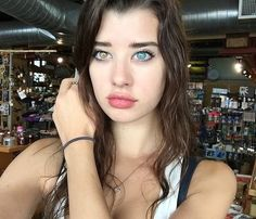 Sarah McDaniel  Sarah's right eye is yellow-brown, while the left one is a lovely bonnie blue. Not only is it 'groovy', it is also downright stunning, and slightly hypnotic. And for an aspiring model in a highly competitive field, it's potential gold.