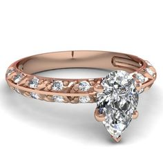 0.70 Ct Sparkling Pear Shaped Diamond Engagement Ring Delicacy Pave Set 14K Rose Gold
