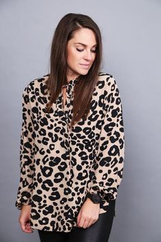 You just can't go wrong with leopard like this. Paired here with our 'Zip Your Lips Suede Jacket' makes for an unstoppable outfit! Polyester. Brown + black leop